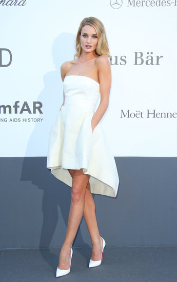 Rosie Huntington-Whiteley looked fresh as ever in all white at amfAR's Cinema Against AIDS Gala at Cannes. She paired a strapless bustier with a matching high-low skirt, both by Dior, and pointy pumps for the special occasion.