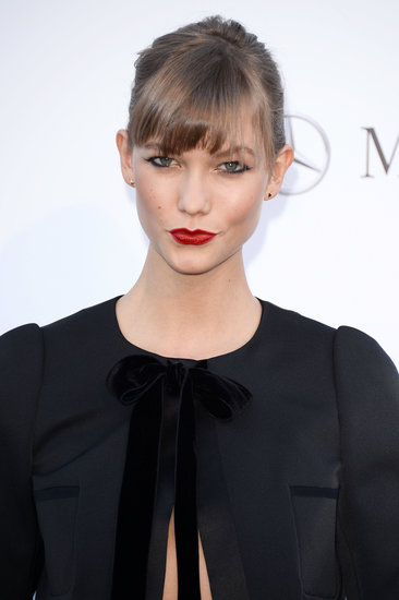 Karlie Kloss wore her famous bob pulled back with her bangs dusting her eyes. She went for a classic red lip coupled with well-lined eyes.