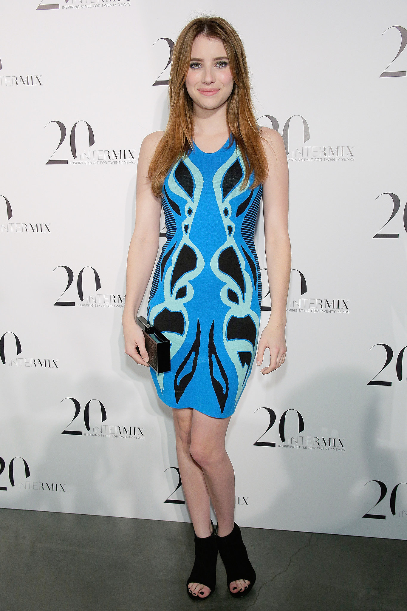 At the Intermix 20th Anniversary celebration in NYC, Emma Roberts showed off a fabulous exclusive Ohne Titel for Intermix minidress and black peep-toe booties.