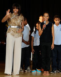 Michelle Obama and Kerry Washington spoke on stage at Savoy Elementary School.