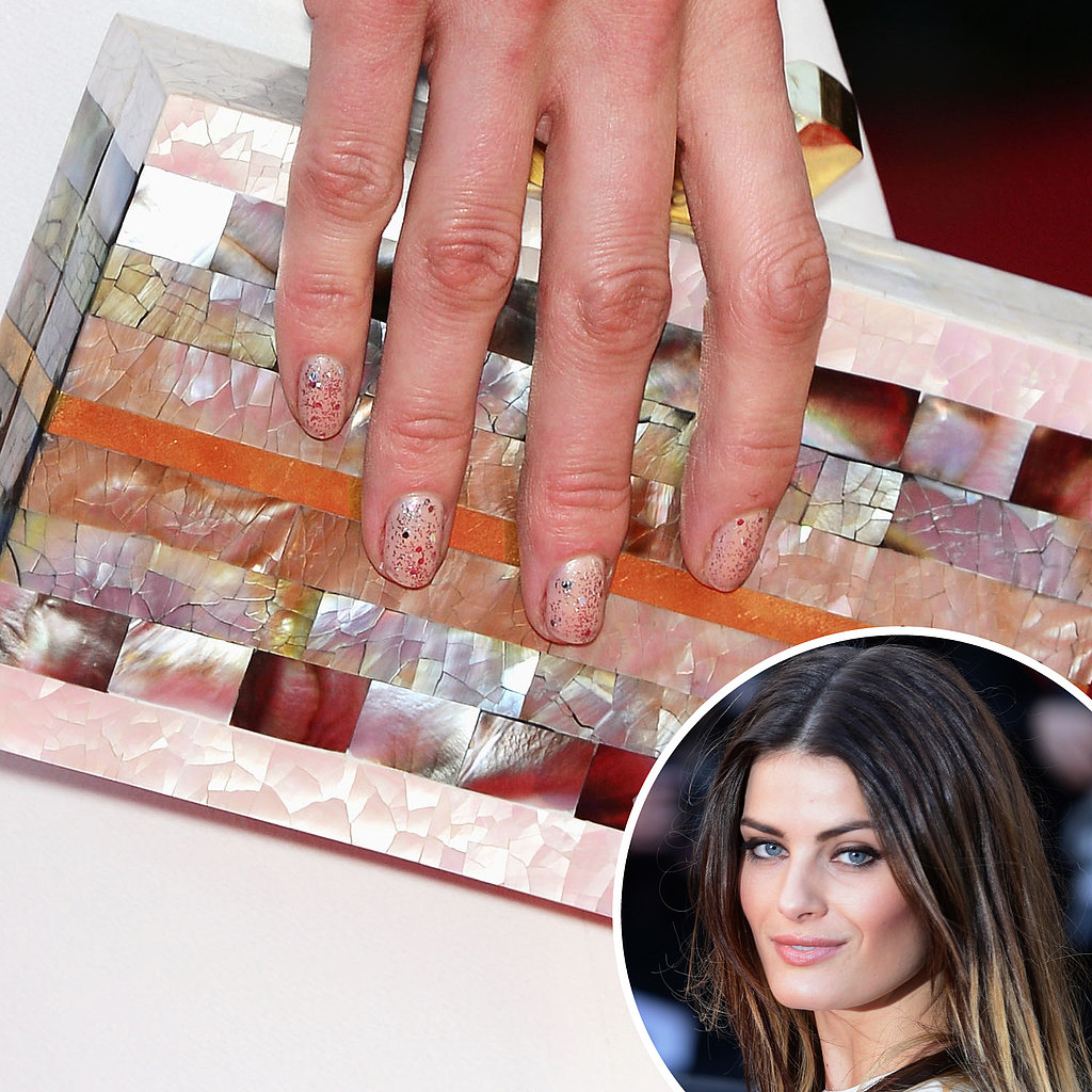 On the red carpet for The Immigrant, model Isabeli Fontana wore a nude polish with a glitter top that went with her ornate clutch.