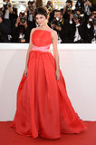 Prada's orange-red silk gazarre, accented with a touch of petal pink, looked lovely on actress Audrey Tautou.