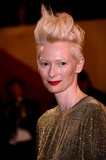 Tilda Swinton hair took a new height with a styled pompadour and fiery red lipstick.
