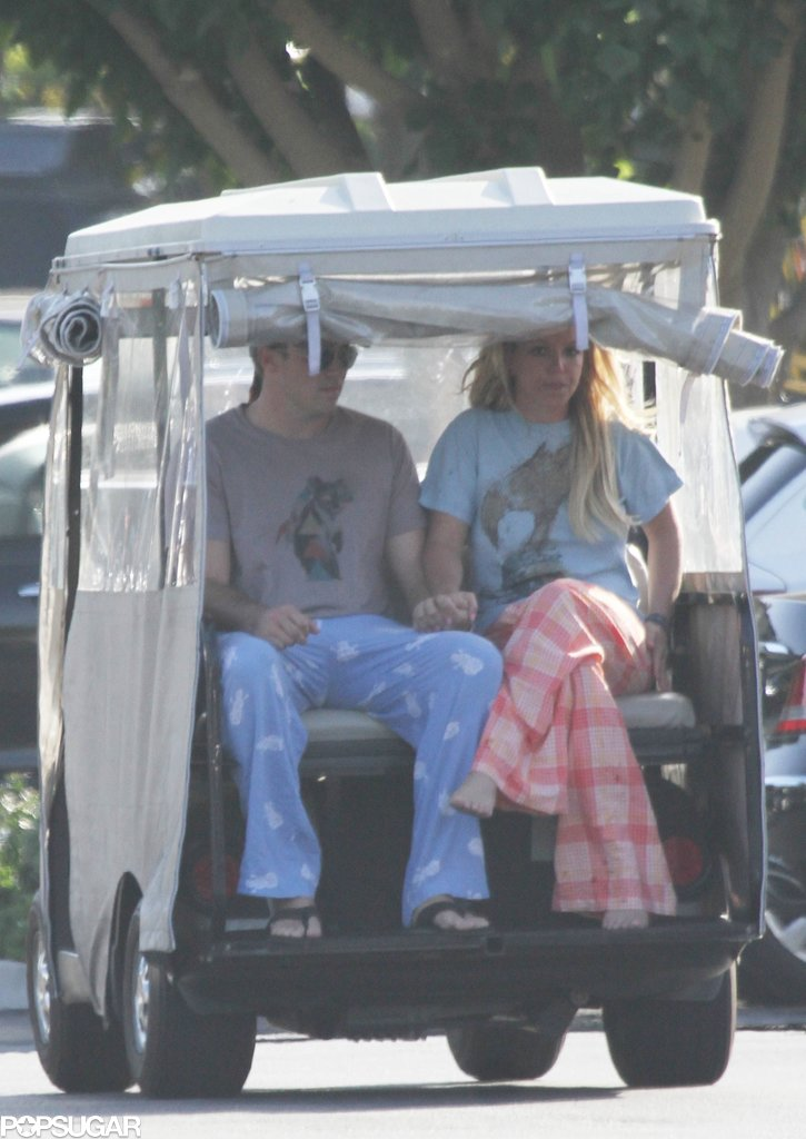 Britney Spears and David Lucado held hands during their golf cart ride.