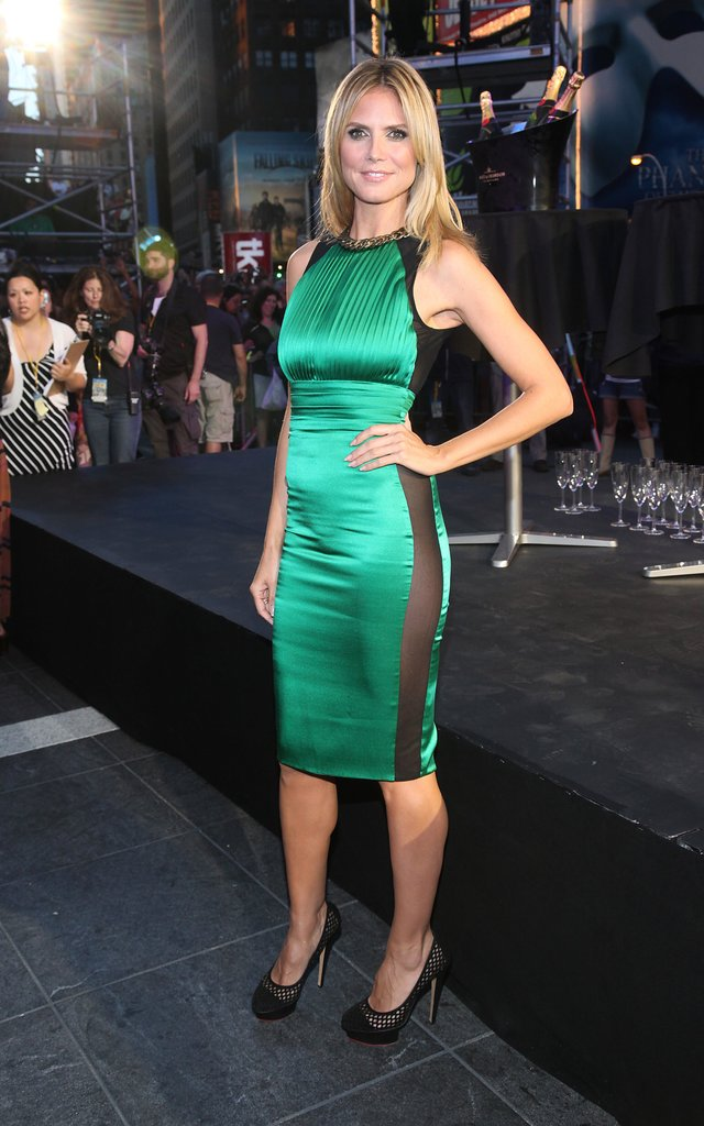 Klum had us green with envy posing in an emerald sheer-inset Thomas Wylde creation and caged Charlotte Olympia pumps for a Project Runway event in 2012.