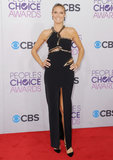Klum hit the 2013 People's Choice Awards red carpet in a cutout Julien Macdonald gown with sequin trim and a stem-baring thigh-high slit. She balanced her high-impact gown with black crisscross pumps and a sleek ponytail.