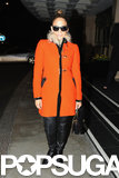 Jennifer Lopez wore an orange coat in London.