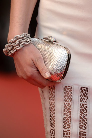 Sarah Marshall wore a chained bracelet and carried a textured platinum clutch.