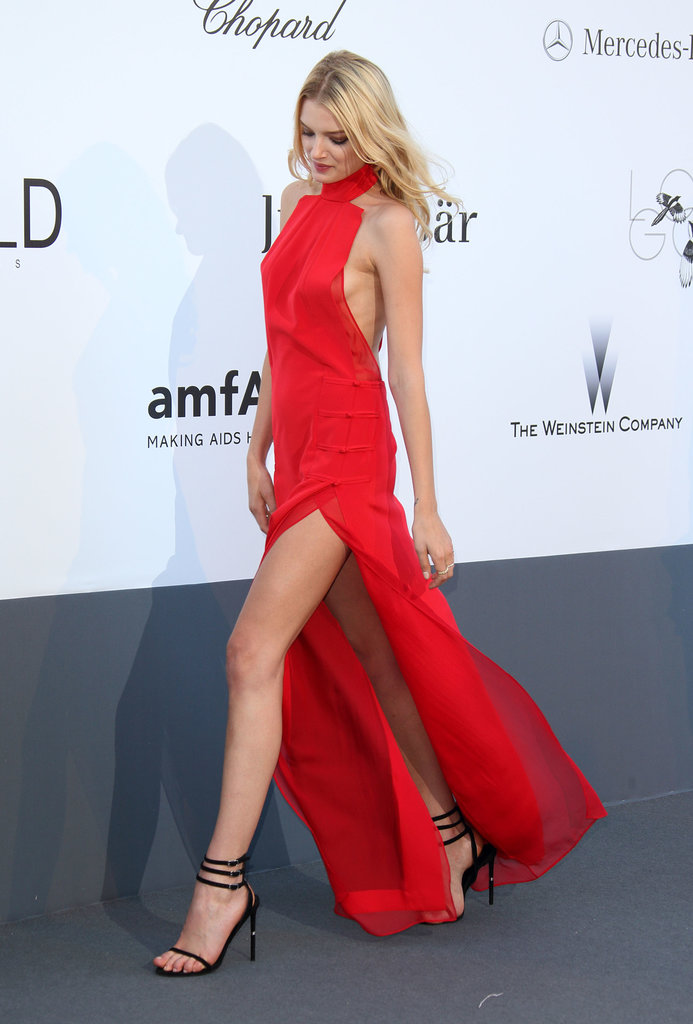 Lily Donaldson made an entrance in a wisp of a red-hot halter gown with a thigh-high slit and a side-baring silhouette.