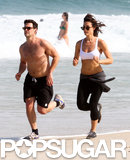 Justin Bartha and Lia Smith went running on the beach in Brazil.