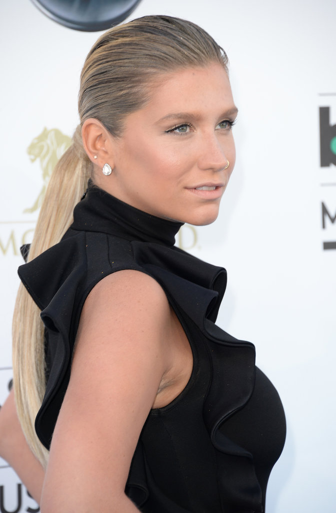 Ke$ha's two-textured ponytail is an easy option post-swim. Just add a touch of gel to the roots and flat-iron the ends.