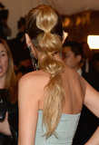 It's easy to re-create Blake Lively's Met Gala ponytail. Use clear hair ties to section the ponytail and fluff each portion for the hourglass shape.