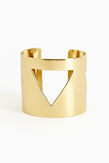 This Nasty Gal pyramid cutout cuff ($20) would be a sleek complement to