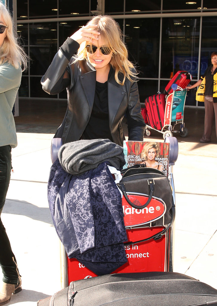 Lara Bingle Touches Down in Sydney Flashing Her Signature Smile