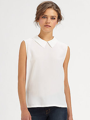 Equal parts sweet and a little preppy, this Equipment Elliot boxy silk top ($188) makes it easy to channel that effortless on-the-go style that we love from Miranda Kerr. Plus, there's no better silky blouse than an Equipment blouse.  — HW
