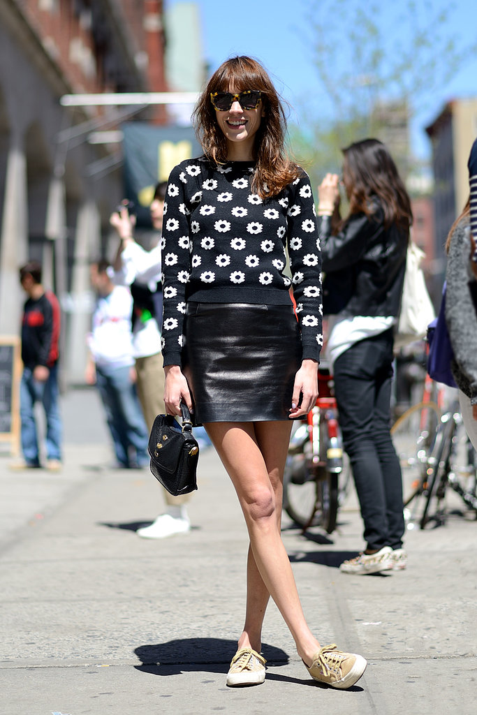 We're smitten with Alexa Chung's accessible play on Summer leather. Add a sweet knit and your favorite sneakers to temper any sexiness of the leather miniskirt. Source: Le 21ème | Adam Katz Sinding