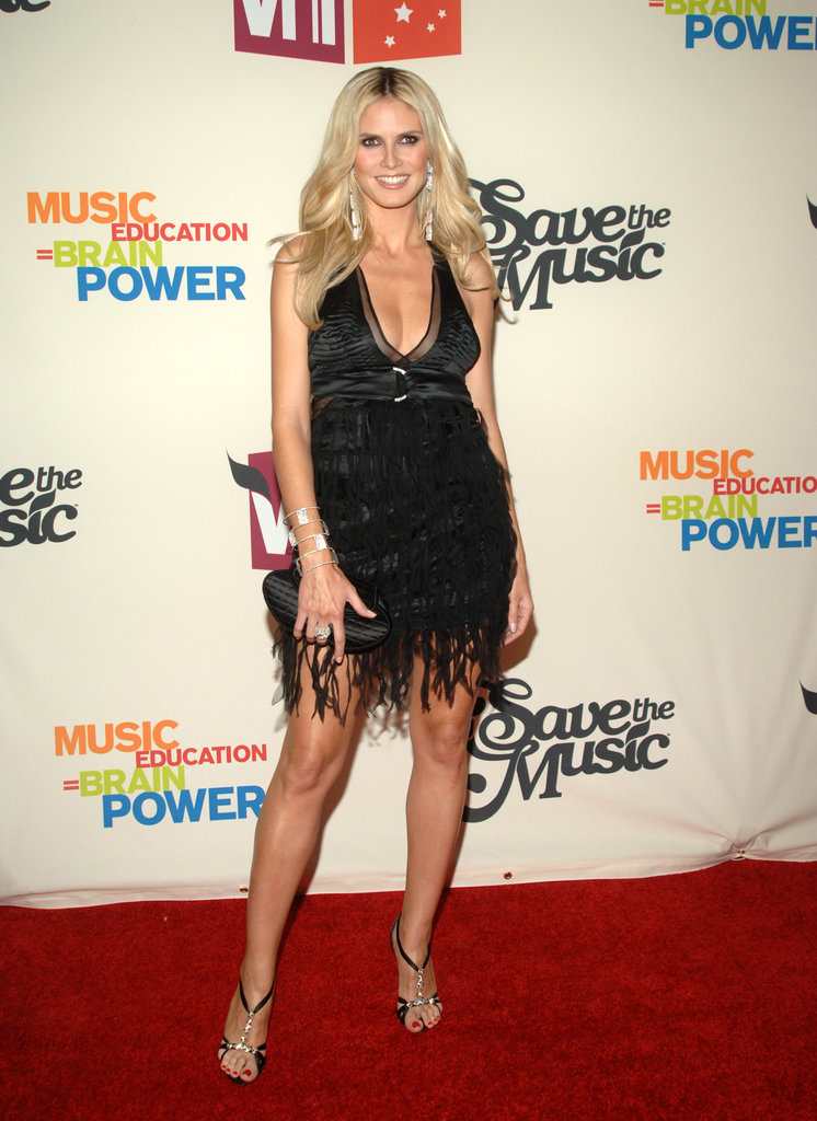 Heidi posed in a black satin halter with shredded tulle overlay and stacks on stacks of diamond add-ons at VH1's 2005 Save the Music benefit in NYC.