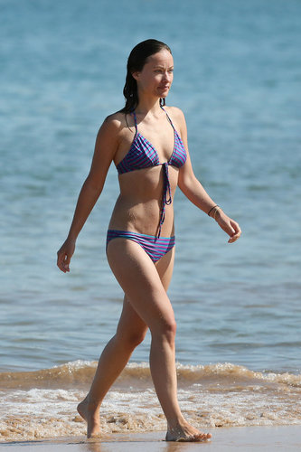 Olivia Wilde took a dip in Maui wearing a triangle bikini featuring blue and purple stripes.
