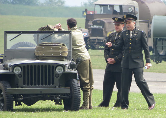 George Clooney and Matt Damon slipped into costume to shoot scenes for their new film, The Monuments Men, in Duxford, England.