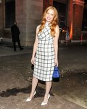 In Venice at a Trussardi dinner, Jessica Chastain chose a high-necked black and white dress that hit under the knee. She added a simple white pump to the look and brought in some color with a bright blue top-handle bag. Source: Neil Rasmus/BFAnyc.com
