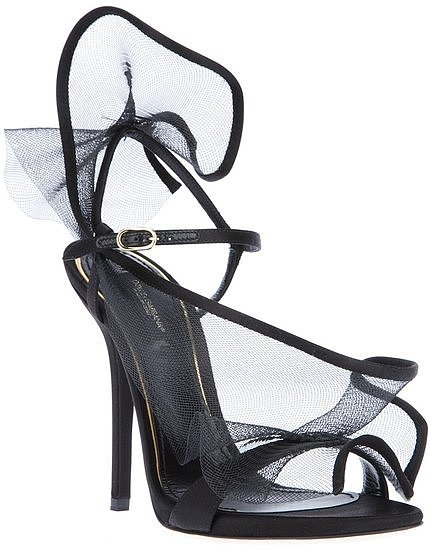 For the modern-meets-nonconformist bride (with a flair for darker hues, of course), try these Dolce & Gabbana black mesh sandals ($706). We love the extradramatic effect of the overlay.