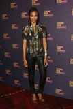 Zoe Saldana shimmered in her metallic short-sleeved Gucci jacket and leather leggings.