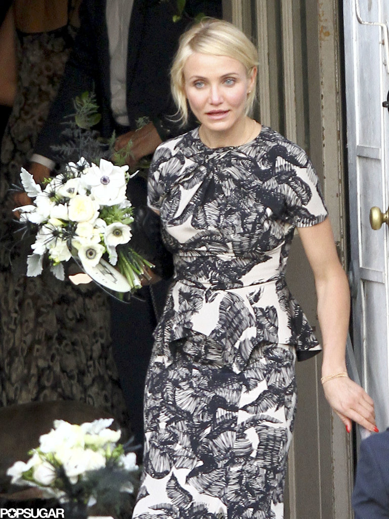 Cameron Diaz carried a bouquet during her friend Lake Bell's wedding with artist Scott Campbell in New Orleans in June 2013.