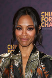 Zoe Saldana accented her eyes with a dark black kohl eyeliner, while her hair was pulled back into a loose updo.