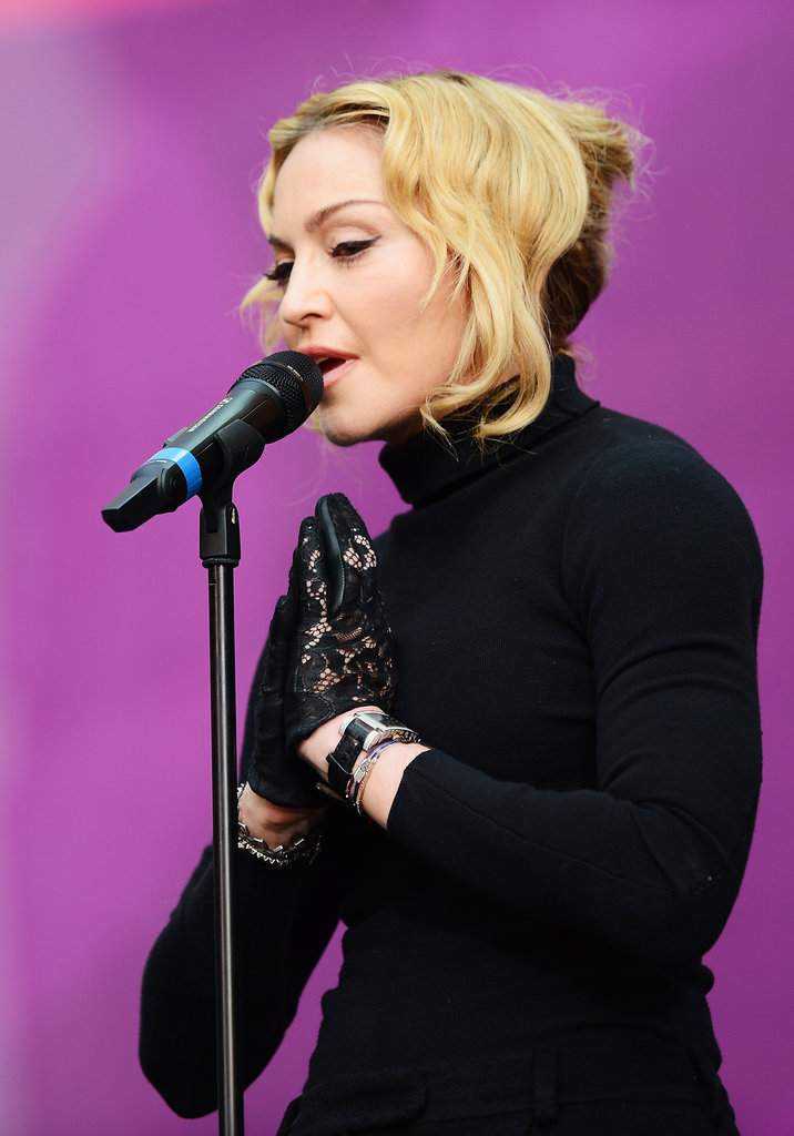 Madonna also performed at the event with her hair pulled back into a French roll with loose tendrils around the face. For her makeup, the iconic songstress stuck with the basics.