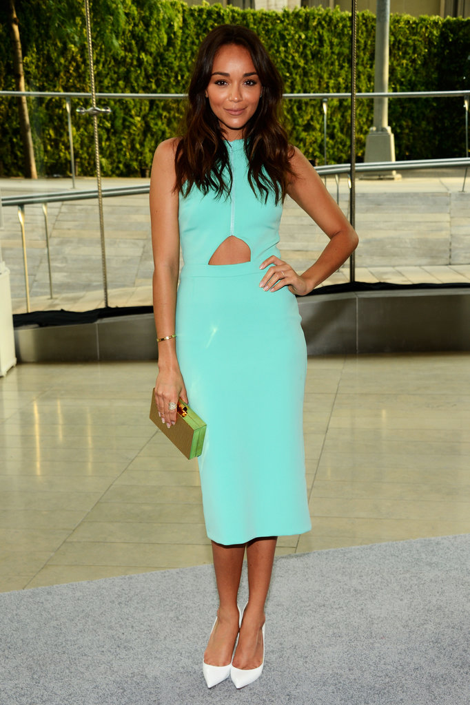 Ashley Madekwe was a breath of fresh air in her turquoise cutout dress, and we can't think of a better companion than her white Christian Louboutin pumps and Charlotte Olympia clutch.
