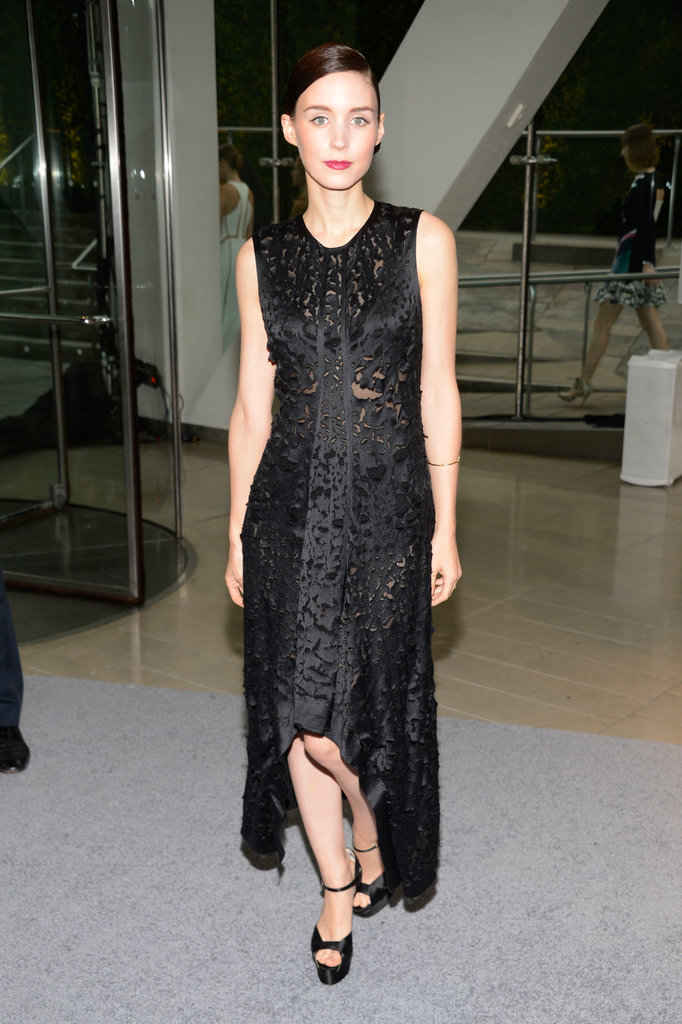 Rooney Mara made a quiet impact in her Calvin Klein Collection high-low dress and black satin ankle-strap Brian Atwood sandals.