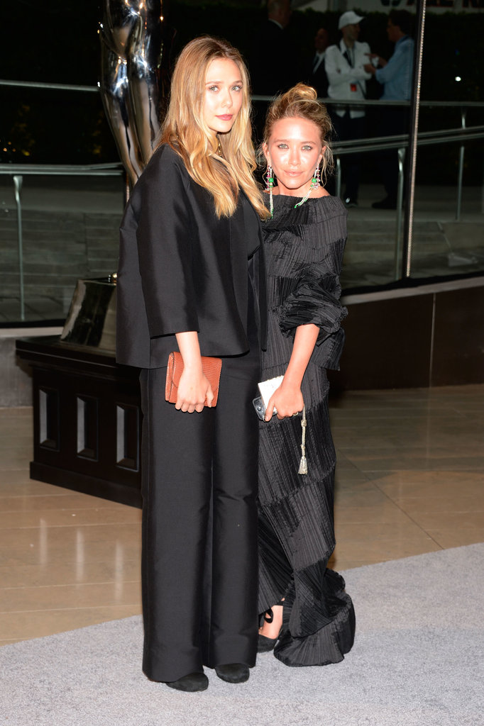 Elizabeth and Mary-Kate Olsen coordinated in their black ensembles. Elizabeth opted for pants, while Mary-Kate wore a textured gown designed by Issey Miyake.