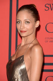 A brick-red lipstick added a hint of colour to an otherwise golden palette for Nicole Richie.