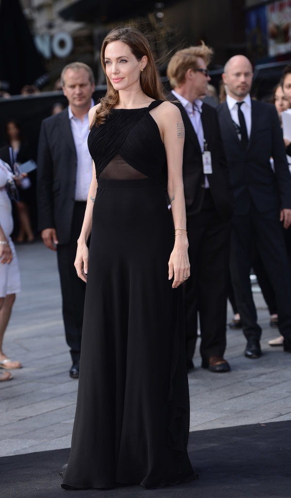In the same vein of her usual red carpet gowns, this custom Saint Laurent dress was sophisticated and classic, letting Jolie's natural beauty take focus.