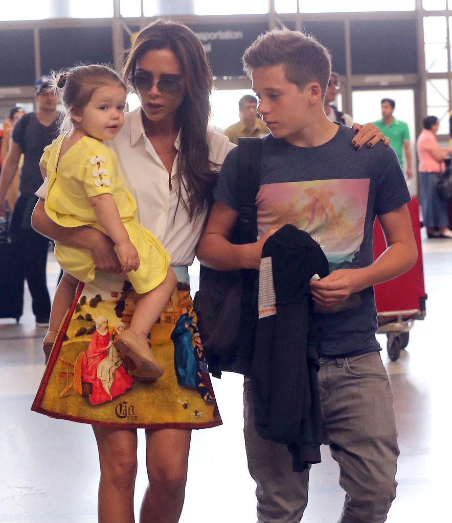 Victoria Beckham huddled up to Harper and Brooklyn before taking a flight out of LA.
