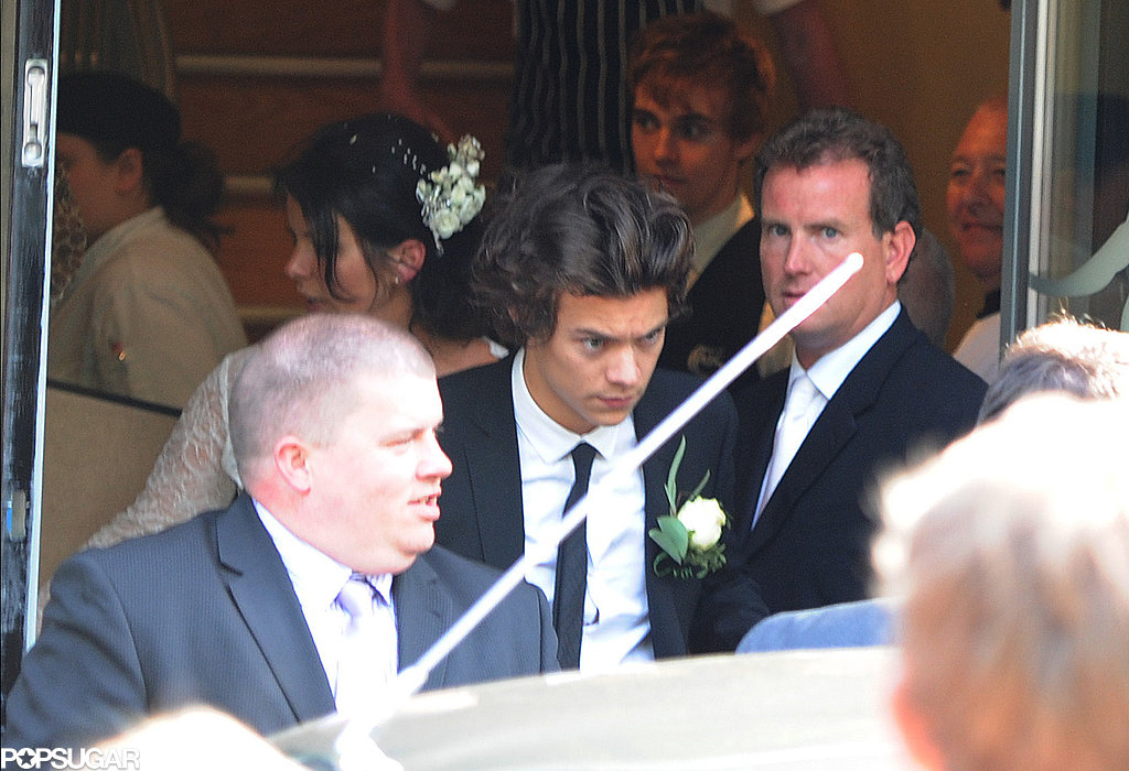 Harry Styles wore a boutonniere and a black suit.