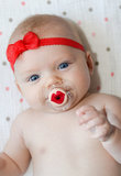 Stop pouting with pout, a bright red pacifier pout ($14), that is.