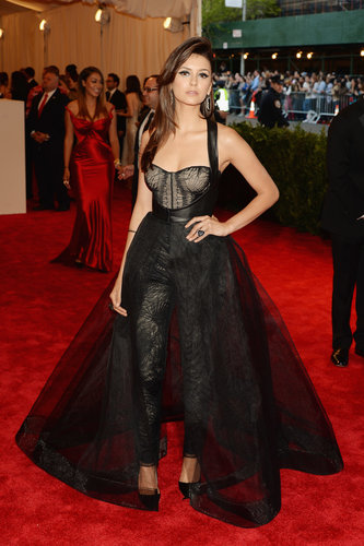 For the 2013 Met Gala, Nina Dobrev swapped her signature body-hugging creations for a custom black Monique Lhuillier jumpsuit-meets-dress. Her punk-chic ensemble composed of