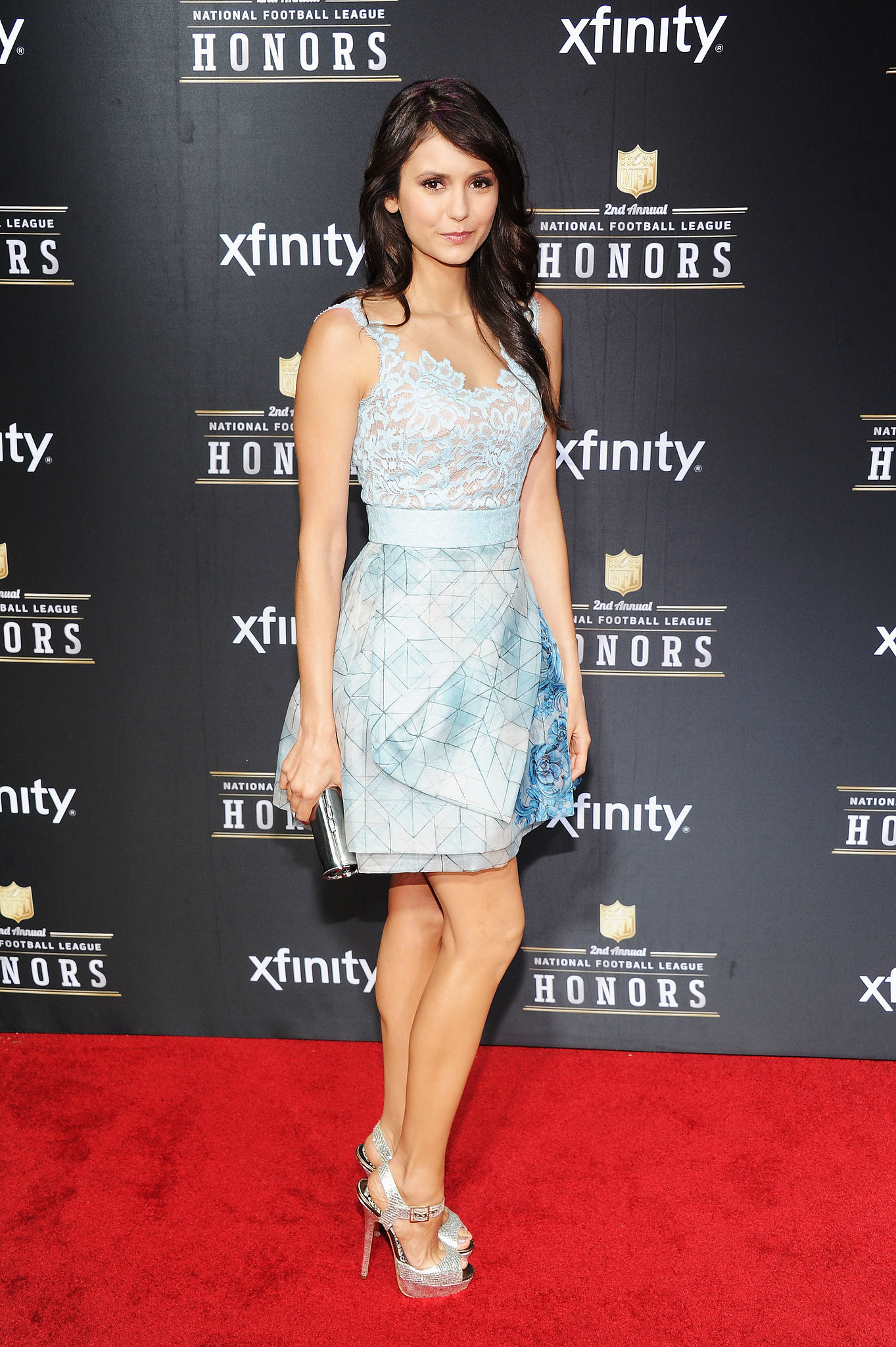 At a first glance Dobrev's light-blue Zuhair Murad mini might look sweet, but upon closer inspection the sexy lace top detail and geometric floral print skirt packed a major fashion punch.