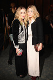 Twinning combo: At the 2009 CFDA new members reception, the darling duo polished their gorgeous gowns with ornate jackets.  Mary-Kate topped her black gown with a velour brocade jacket and colourful miniclutch. Ashley contrasted her cream-coloured crepe gown with a black tweed jacket and burgundy platforms.