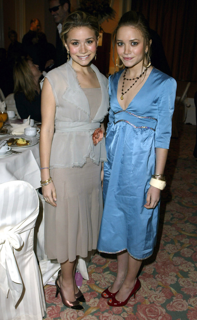 Twinning combo: Midi dresses and stacks of accessories were all the rage for The Hollywood Reporter's Women in Entertainment Power 100 Breakfast in December 2003.  Ashley topped her drop-waist dress with a gauzy wrap, complete with an orange rose brooch. Mary-Kate donned a light-blue metallic-trim number with dark red pumps.