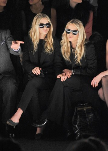 Twinning combo: If black is the color of power, then the Olsens were reigning queens at the J. Mendel show during Fall 2012 New York Fashion Week.  Ashley donned an all-black suit with retro shades. Mary-Kate took inspiration from her twin working the exact same look.