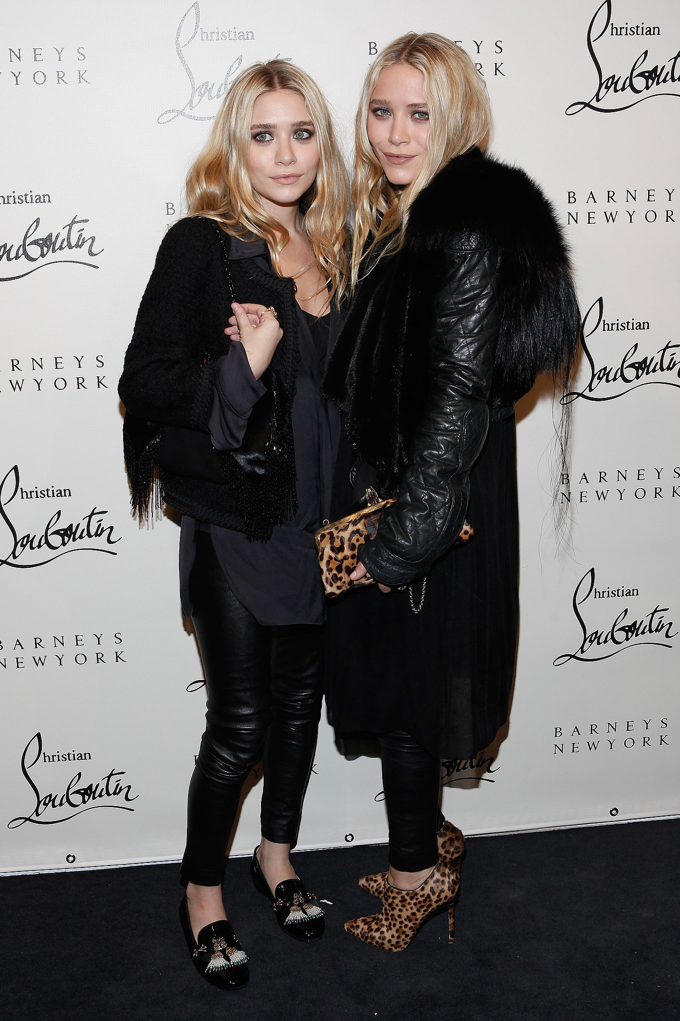 Twinning combo: For Christian Louboutin's November 2011 soiree the girls styled all-black ensembles with statement-making shoes.  Ashley juxtaposed edgy leather leggings with a smart tweed jacket and Christian Louboutin tasseled driving loafers. Mary-Kate injected a pop of print with a leopard clutch and matching ankle booties, both by Christian Louboutin.