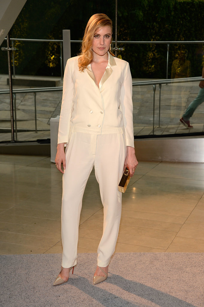 Greta Gerwig took the menswear route in an ivory tuxedo jumpsuit.