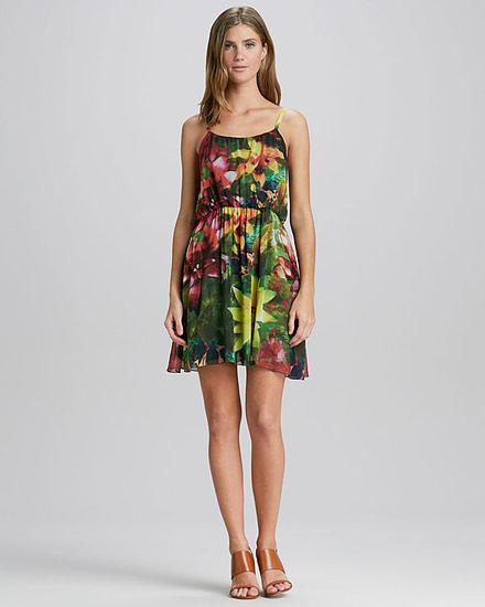 Alice + Olivia's floral-print dress ($345) will freshen up the scene. Just add an armful of gold bangles and strappy sandals to make things pop even more.
