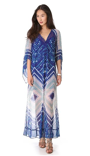 This BCBG Max Azria printed gown ($368) can totally double as a cover-up, but for the wedding festivities, we recommend adding a statement necklace and equally dazzling sandals.
