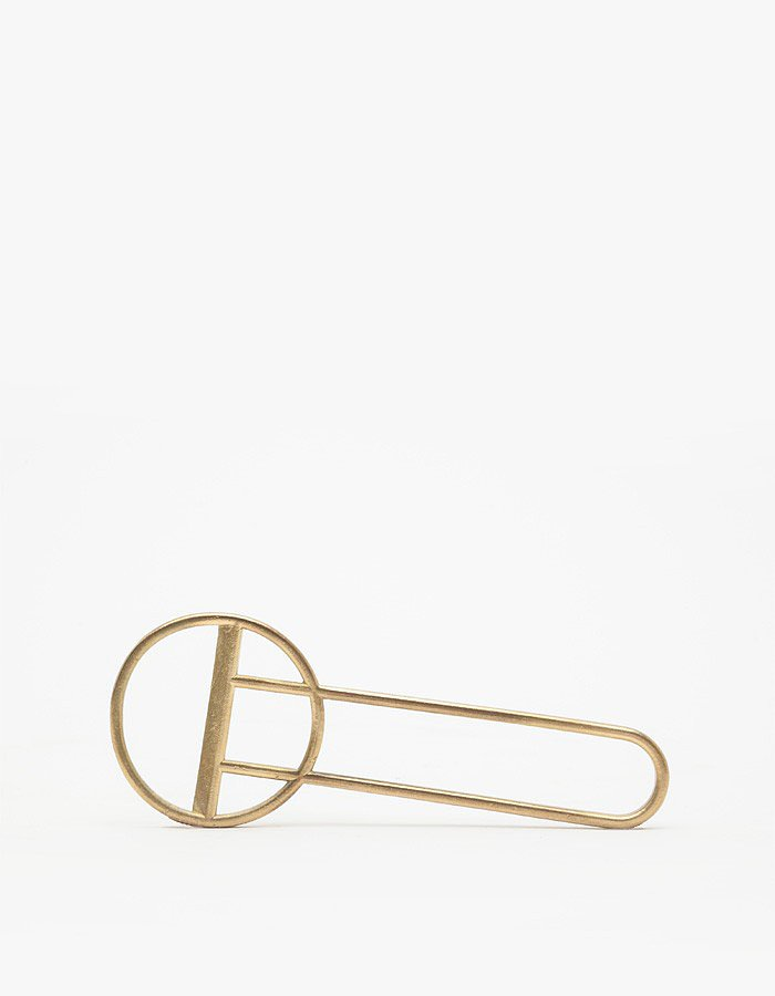 The bottle opener ($80) is elevated to art in handcrafted brass.
