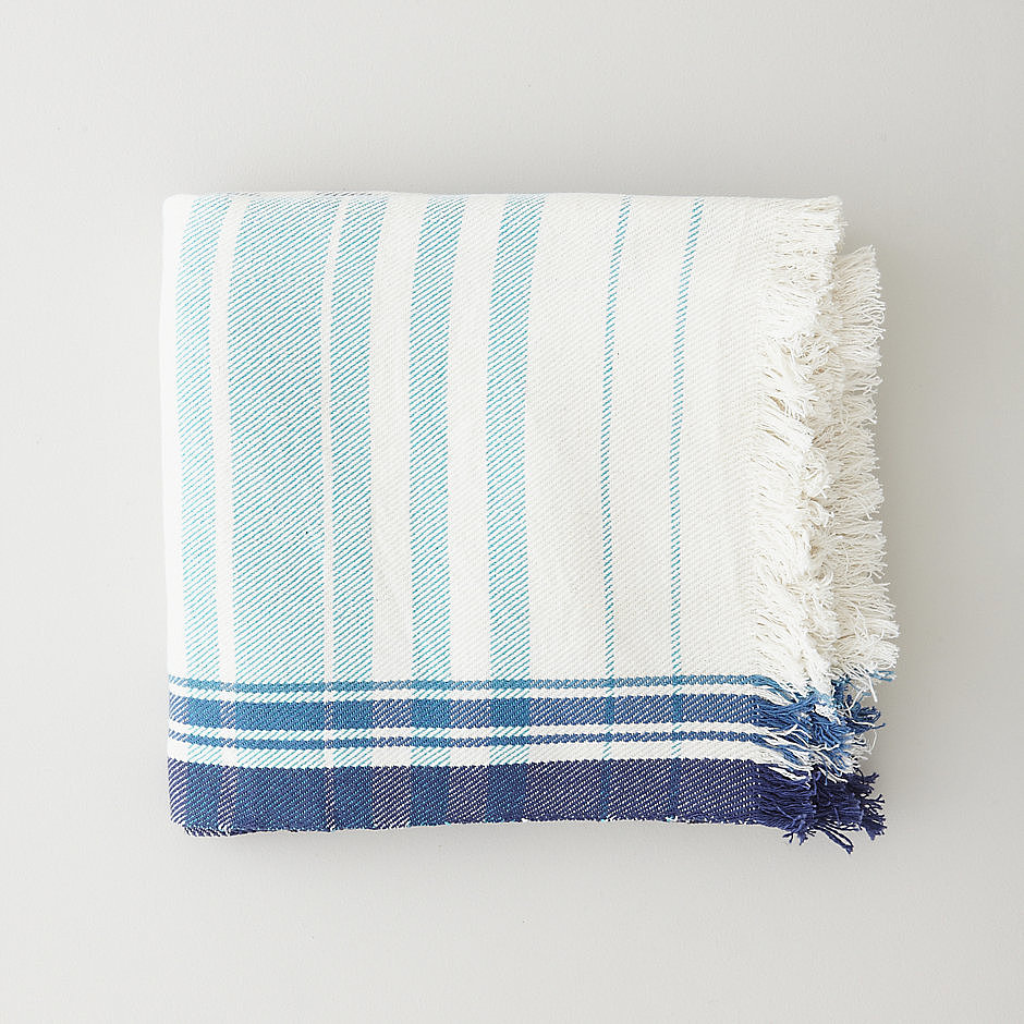 You might be tempted to bring this Ocean Blanket ($200) to the beach, but we suggest curling up with it in bed.