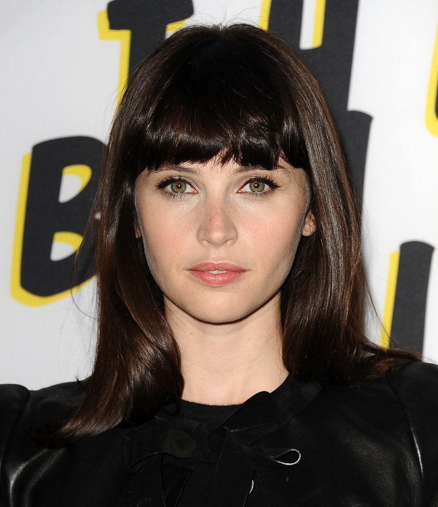 Curled blunt bangs, precise liquid liner, and flushed skin were the key to Felicity Jones's gorgeous look at the Bling Ring premiere.