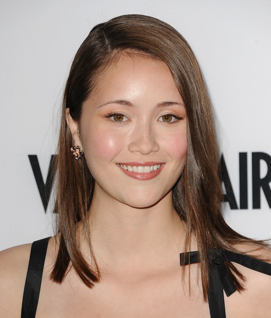 Actress Katie Chang wore a touch of sheer gold shadow on her lids to accentuate her green eyes, while the rest of her makeup remained neutral.